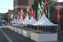 White Fete Stalls with Flags - Festival Hire